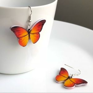 Jewelry - NEW Acrylic Orange Butterfly Earrings